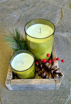 Hand poured soy candles in recycled, cut wine bottles and pallet wood box.