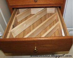 Siobahn says:My husband made a wonderful diagonal drawer divider insert to keep large untensils organized in the drawer (and off the counter).  I blogged