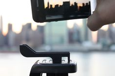 The Glif is a very cool piece of mini-hardware to have in my backpack.  It is a tripod mount for an iPhone 4.  Check it out at: http://www.studioneat.com/products/glif-for-iphone-4