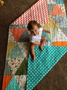 triangle quilt ... I want to do this for each kid with our favorite baby outfits ... Ben's idea not mine, love him!