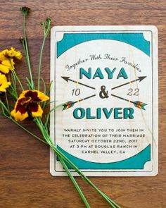 These whimsical invites featured two crossed wooden arrows -- a spin on summer camp archery lessons