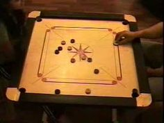 Demonstrates one complete carrom board game in action