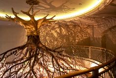 """Donald Lipski's """"Sirshasana, 1998"""". With branches that span twenty-five feet and 5,000 brilliant crystal pendants, this chandelier is suspended above the street level entrance to the Grand Central Market."""