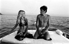 Alain Delon looking amazing on a boat at dusk with Brigitte Bardot, who also looks amazing. Or, Alain Delon proving your life sucks.