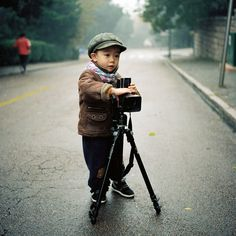 ^This was seriously me when I was a kid--little Asian kid with a fancy, complicated camera and big ideas!