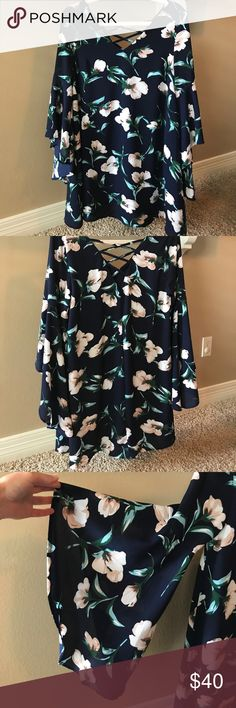 Women's dress Navy floral dress w/ bell sleeves & crisscross back. Would pair perfectly w/ tan knee high boots for fall! Dresses Long Sleeve