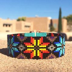 A personal favorite from my Etsy shop https://www.etsy.com/listing/491602683/elements-bead-loom-bracelet-beaded