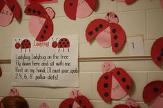 Would make for a fun addition game; each ladybug has a different number of spots (ie. 4 on one wing and 2 on the other).  Open the wings to find what 4 + 2 equals.  For when L. gets older...