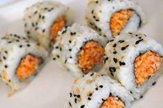 SPICY CRAB SUSHI ROLL RECIPE ==  Ingredients==  Sushi Rice (prepared, one large handful), Nori Sheet (1/2), Toasted Sesame Seeds, Black Sesame Seeds, Spicy Crab (srirachi hot sauce, shredded imitation crab sticks, masago, mayonnaise) ====