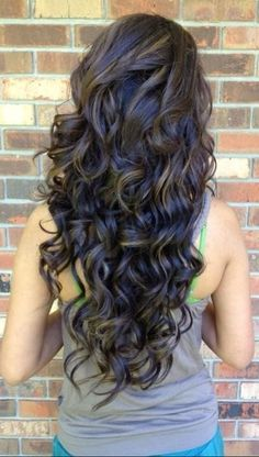 Dark long curly hair...shooting for this long in the future!