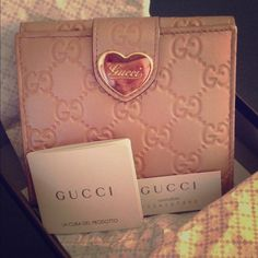 Authentic GUCCI wallet. ❤️LOWEST❤️ Used about a handful of times. Practically new. From the 2011 collection. Guccisima pink leather, golden hardware, gold heart with signature Gucci cursive writing. I ONLY sell AUTHENTIC. Comes with original box, tissue, authenticity cards, gift bag, etcetera. Very subtle scratches on hardware from the few uses. NO major scratches. Gucci Bags Wallets