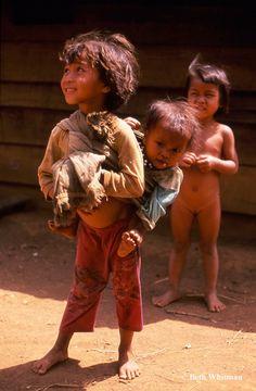 /  Vietnam (Source: sablesmoke, via spiritual-sublimity).  Children taking care of children, but still a smile.  Love to them all.  ak