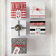 Scrapbooking paper, ribbon, and embellishments easily dress up these festive gifts! http://www.bhg.com/christmas/gift-wrapping/pretty-gift-wraps-and-bows/?socsrc=bhgpin120814classicgiftboxes&page=5