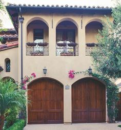 The wooden ETO garage doors pull the whole look of this Spanish style home together.