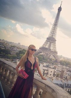 Paris Hilton wearing Edie Parker Pink Flavia Clutch and Chanel Butterfly Acetate Sunglasses.