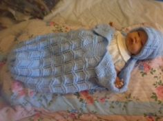 Hand knitted baby's blue cocoon/papoose and hat set. Hand knitted baby's blue cocoon/papoose and hat set.