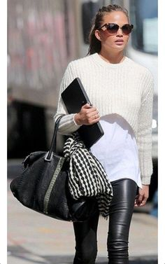 Bump watch  The former Deal or No Deal model wore a belly-baring jumper  over a long white shirt, black leather leggings, and Balmain gladiator  heels I just ... 19d9bc1e6520