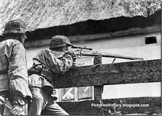 A Waffen SS soldier takes aim in 1941 on the Eastern Front.