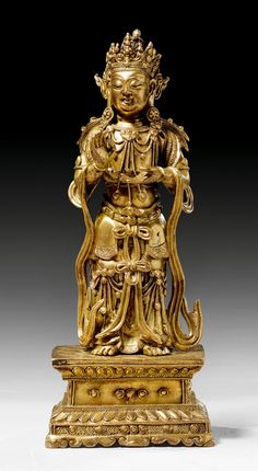 FIGURE OF MAITREYA,  tibetochinese, 15th century.   Fire-gilt bronze.   H 25 cm.