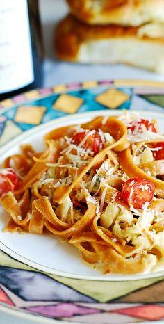 Lobster pasta in white wine, porcini and tarragon cream sauce over Tomato Basil Garlic Fetuccini | JuliasAlbum.com | main dish recipes