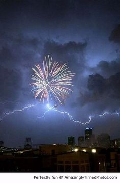 What is better than fireworks and lightning...pretty cool how the firework opened just as there was a flash of lightning.