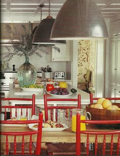 Peter Dunham, House Beautiful Industrial Pendants over kitchen island and table.