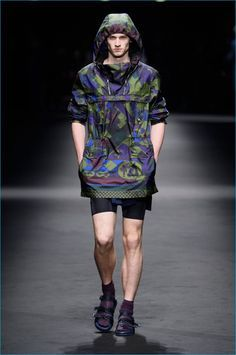 Versace prints are toned down for spring-summer 2017, executed in dark hues.