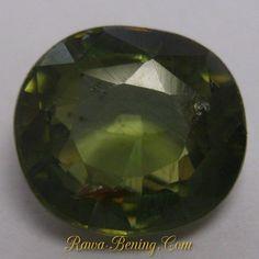 Batu Permata Natural Zircon Hijau Greyish Oval Cut 2.73 carat Bagus