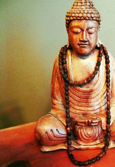 Buddha. Great holder for our malas.