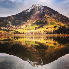 Colorado has a way of delivering the goods like no place else this time of year. Snow, fall colors, and a small cabin on the lake. Can you find it? #epic #fall #colorado by timkemple