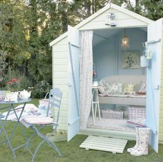 Re-decorated garden shed........would be so fun for the girls to have a place to have tea and picnics.....