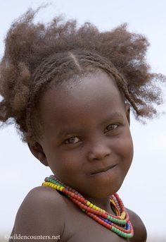 Portrait of young girl from the Desanech tribe, N.E Lake Turkana, N.Kenya