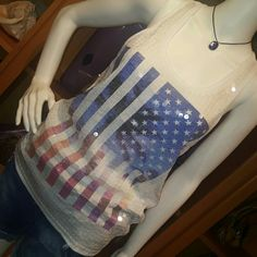 PINK tank top sz. Xs NWT Just in time for 4th of July! Patriotic racer tank. Wear it to your 4th of July picnic. Flag is in blues and pinks,front is all sparkles! PINK Victoria's Secret Tops Tank Tops