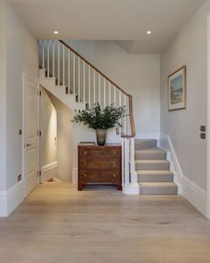 Beautiful soft tones of white, bone, honey and pale stone in this contemporary London home … especially love the kitchen with its wide-planked wood floors, striking marble island and counters, plus th Design Entrée, Interior Design, Interior Architecture, Hallway Inspiration, Hallway Ideas, Hallway Pictures, Wooden Stairs, Painted Stairs, Bannister Ideas Painted