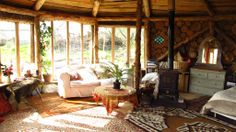 The Hobbit House, Plan-it Earth Eco Project, Cornwall. Roomy, with comfortable beds, cosy wood burners and beautiful lanterns, this is luxurious eco living http://www.organicholidays.co.uk/at/3142.htm