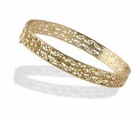 Mesmerizing Moroccan Gold Bracelet. Airy solid gold filigree bangle with floral detailing at the top and bottom rows. Bright, closed back, and hinges at the front to open.