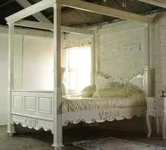 Reproduction antique French style four poster bed, painted white, carved. Designer luxury bedroom furniture.