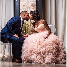 This dress! @watterswtoo divine blushing gown that captures our heart along with the sweetest of kisses between the bride and groom. She not only wore one but two #Watters gowns for her big day! Photo by @danielbostick. #Watters #weddingdress #blush #glam