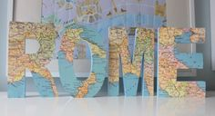 DIY City Name Map Art ~ Materials:  Wooden block letters; A map (I used a piece of map wrapping paper}; Craft paint; Mod podge. How To:  - Paint the wooden letters in a color that matches the map. - When paint is dry, trace the letters on the map and cut out. - Paint mod podge on the front of each letter and place the cut out maps on each one.