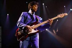 Rare pic of Prince playing the bass!