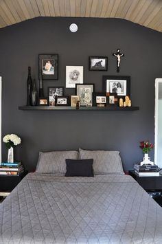 I love the little knicknacks and photos used to define the bed space without a headboard. I also appreciate all the black and the use of weird/creepy stuff without feeling like I'm working at Hot Topic again.