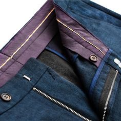 100% Linen Trousers in Classic Fit Dark Navy Linen Trousers made with inner waistband, inside button and hook closure, metal zipper, double back pockets with button closure, waistband with beltloops, slanted front pockets and creases on legs.