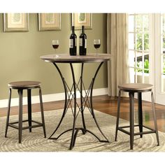 Bring a contemporary industrial look to your bar or casual dining room with this vintage charming counter-height table and stool set. The distressed weathered wood table top and stool seat contrast with the black base and will easily blend with any decor