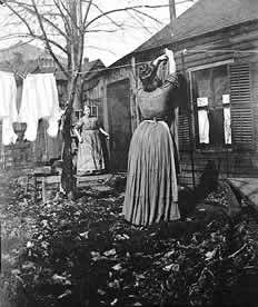 Women hanging laundry. Mrs. VanderBosch and her daughter on wash day, 243 North Smith, St. Paul, ca. 1895. Photo courtesy of the Minnesota Historical Society. Hanging laundry