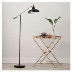 Simple, attractive and there when you need it, the Threshold Crosby Collection Floor Lamp shines its light on what's important. This long, lean lamp is adjustable in 2 places so you can get the perfect position for lighting the room, playing games or reading as long as you need to. The ebony black shade, handle and base pop in contrast with brass hardware for shine and style you can count on.