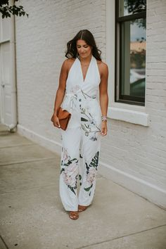 Floral Jumpsuit | A Southern Drawl. White floral print halter jumpsuit+camel lace-up heeled sandals+brown envelope clutch+long earrings+silver bracelet+silver watch. Summer Evening Outfit 2017
