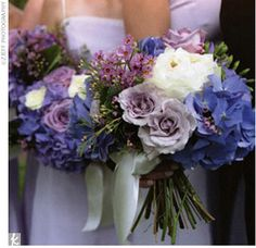 Wearing knee-length lilac dresses with an ivory organza sash, seven bridesmaids carried bouquets of blue, lilac, lavender, and white hydrangeas. Lilac stone bracelets resembling sea glass, given to them by Kathryn, completed the look.