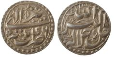 Mughal Empire. Akbar Shah. AR rupee. 963-1014/1556-1605. Dotted circle. Ilahi date and Persian month. Superb specimen. Patna-46. KM-93.14