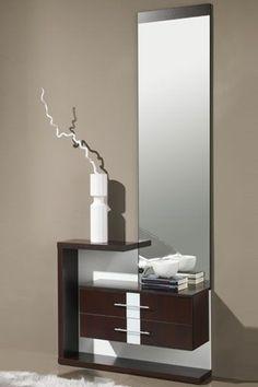 Decore la entrada a su hogar y ponga un toque de color, con este fantástico mueble auxiliar compuesto por espejo y dos cajones. Disponible en las siguientes combinaciones de colores: wengue/naranja, wengue/hueso y ceniza/naranja.