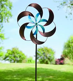 Bring color and motion to your yard with Wind Spinners in all sizes, colors and designs. Get your new wind spinner, garden whirligig or garden spinner here. Kinetic Wind Spinners, Metalarte, Garden Wind Spinners, Wind Sculptures, Garden Sculpture, Metal Garden Art, Black Flowers, Tin Flowers, Welding Projects